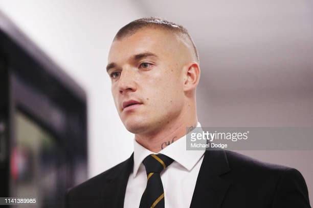 Dustin Martin of the Richmond Tigers walks from the AFL Tribunal Hearing at AFL House on April 09 2019 in Melbourne Australia