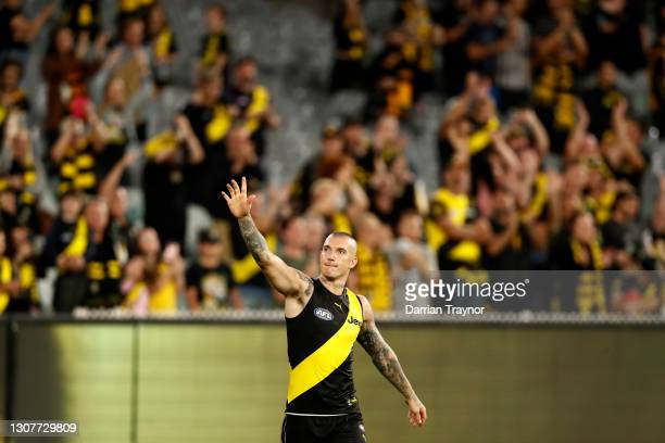 Dustin Martin of the Tigers acknowledges the fans after the round one AFL match between the Richmond Tigers and the Carlton Blues at Melbourne...