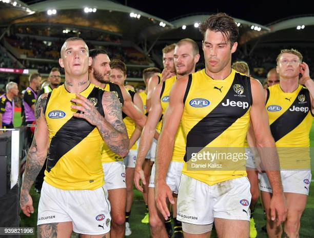 Dustin Martin of the Tigers and Alex Rance of the Tigers walk from the ground after the round two AFL match between the Adelaide Crows and the...
