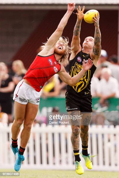 Dustin Martin of the Tigers and Dyson Heppell of the Bombers contest the ball during the JLT Community Series AFL match between the Essendon Bombers...