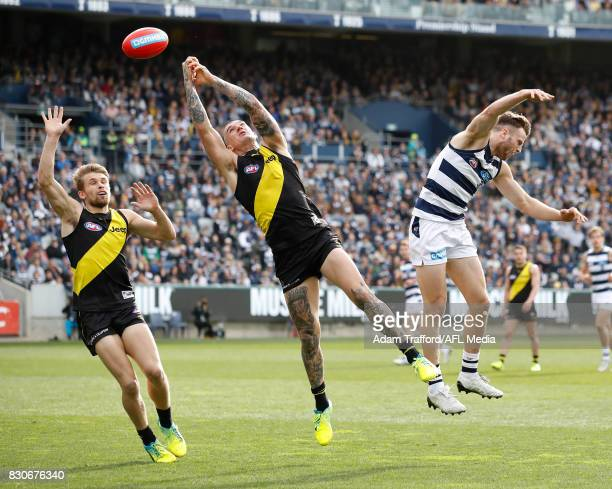 Dustin Martin of the Tigers and Jordan Murdoch of the Cats compete for the ball during the 2017 AFL round 21 match between the Geelong Cats and the...