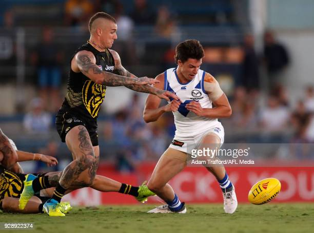 Dustin Martin of the Tigers and Luke DaviesUniacke of the Kangaroos compete for the ball during the AFL 2018 JLT Community Series match between the...