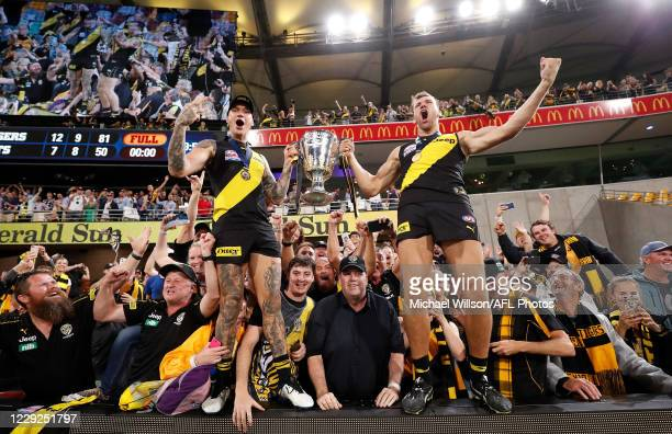 Dustin Martin of the Tigers and Noah Balta of the Tigers celebrate during the 2020 Toyota AFL Grand Final match between the Richmond Tigers and the...