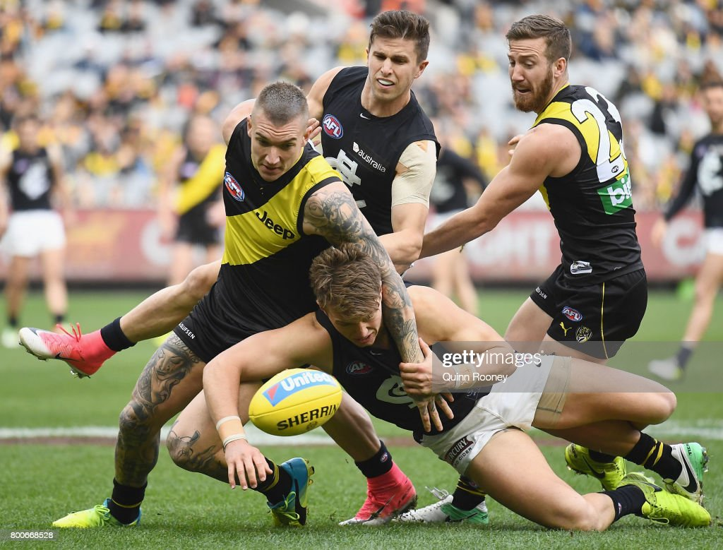 Dustin Martin of the Tigers and Patrick Cripps of the Blues compete for the ball during the round 14 AFL match between the Richmond Tigers and the Carlton Blues at Melbourne Cricket Ground on June 25, 2017 in Melbourne, Australia.