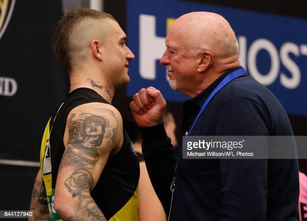 Dustin Martin of the Tigers and Rex Hunt celebrate during the AFL Second Qualifying Final Match between the Geelong Cats and the Richmond Tigers at...
