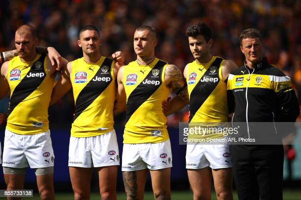 Dustin Martin of the Tigers and team mates during the Australian national anthem during the 2017 AFL Grand Final match between the Adelaide Crows and...