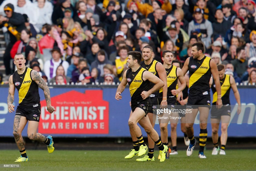 Dustin Martin of the Tigers celebrates a goal during the round 23 AFL match between the Richmond Tigers and the St Kilda Saints at Melbourne Cricket Ground on August 27, 2017 in Melbourne, Australia.