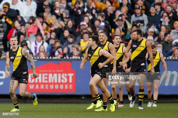 Dustin Martin of the Tigers celebrates a goal during the round 23 AFL match between the Richmond Tigers and the St Kilda Saints at Melbourne Cricket...