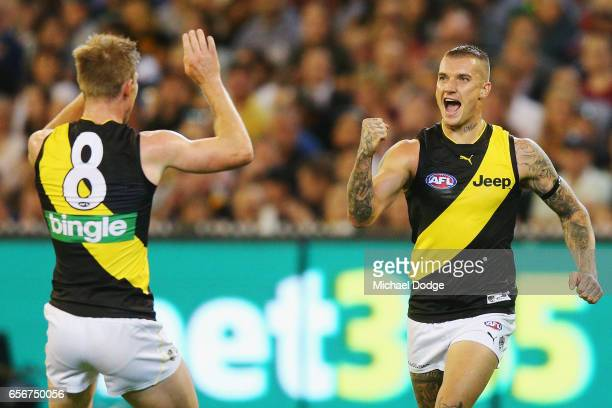 Dustin Martin of the Tigers celebrates a goal with Jack Riewoldt of the Tigers during the round one AFL match between the Carlton Blues and the...