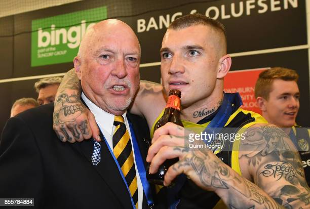 Dustin Martin of the Tigers celebrates in the rooms with Rex Hunt after winning the 2017 AFL Grand Final match between the Adelaide Crows and the...
