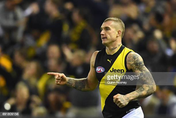 Dustin Martin of the Tigers celebrates kicking a goal during the round 11 AFL match between the North Melbourne Kangaroos and the Richmond Tigers at...