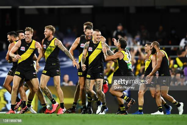 Dustin Martin of the Tigers celebrates kicking a goal with team mates during the 2020 AFL Grand Final match between the Richmond Tigers and the...
