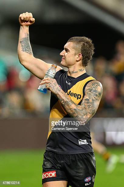 Dustin Martin of the Tigers celebrates winning the round 13 AFL match between the Sydney Swans and the Richmond Tigers at SCG on June 26 2015 in...