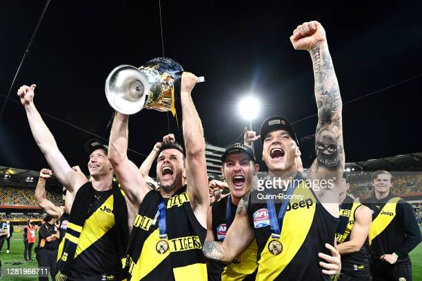Dustin Martin of the Tigers celebrates with captain Trent Cotchin of the Tigers after winning the 2020 AFL Grand Final match between the Richmond...
