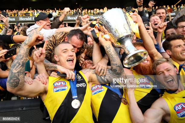 Dustin Martin of the Tigers celebrates with fans after winning the 2017 AFL Grand Final match between the Adelaide Crows and the Richmond Tigers at...
