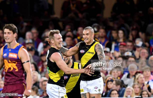 Dustin Martin of the Tigers celebrates with Jack Riewoldt after kicking a goal during the AFL 2nd Qualifying Final match between the Brisbane Lions...