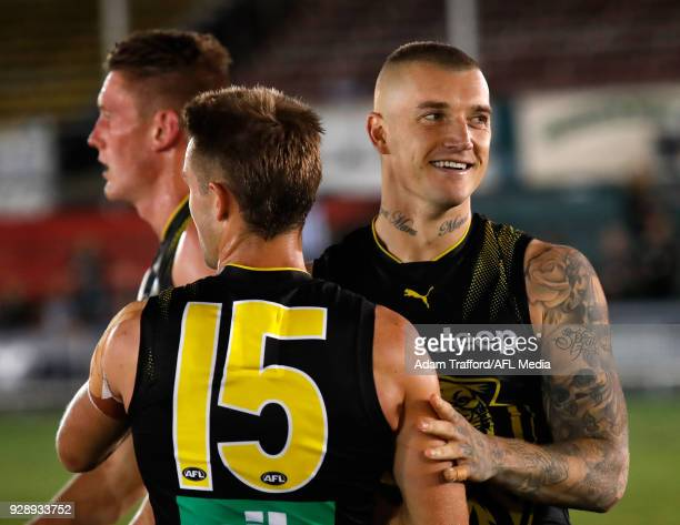 Dustin Martin of the Tigers celebrates with teammates during the AFL 2018 JLT Community Series match between the Richmond Tigers and the North...