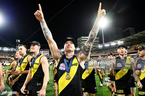 Dustin Martin of the Tigers celebrates with the AFL Premiership Cup after winning the 2020 AFL Grand Final match between the Richmond Tigers and the...