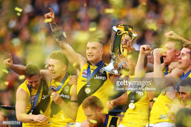 Dustin Martin of the Tigers celebrates with the AFL Premiership Cup on stage after winning the 2017 Toyota AFL Grand Final match between the Adelaide...