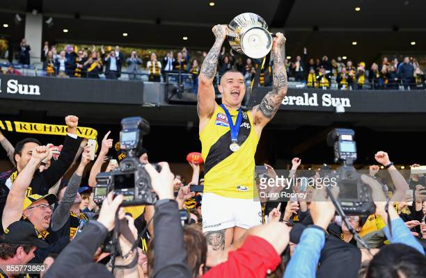 Dustin Martin of the Tigers celebrates with the Premiership Trophy after winning the 2017 AFL Grand Final match between the Adelaide Crows and the...
