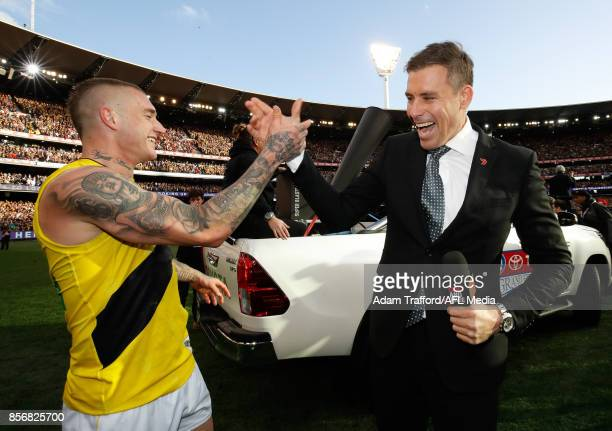 Dustin Martin of the Tigers celebrates with Tigers legend Matthew Richardson during the 2017 Toyota AFL Grand Final match between the Adelaide Crows...