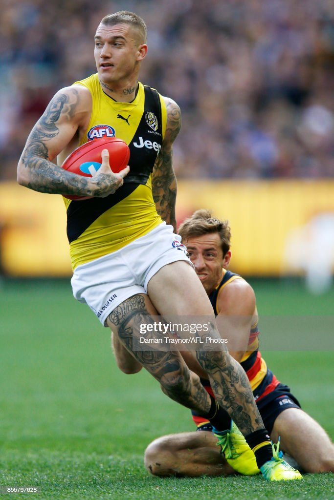 Dustin Martin of the Tigers evades a tackle during the 2017 AFL Grand Final match between the Adelaide Crows and the Richmond Tigers at Melbourne Cricket Ground on September 30, 2017 in Melbourne, Australia.