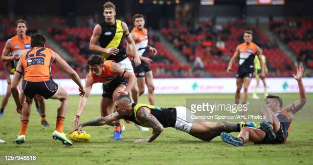 Dustin Martin of the Tigers gathers the ball during the round 8 AFL match between the Greater Western Sydney Giants and the Richmond Tigers at GIANTS...