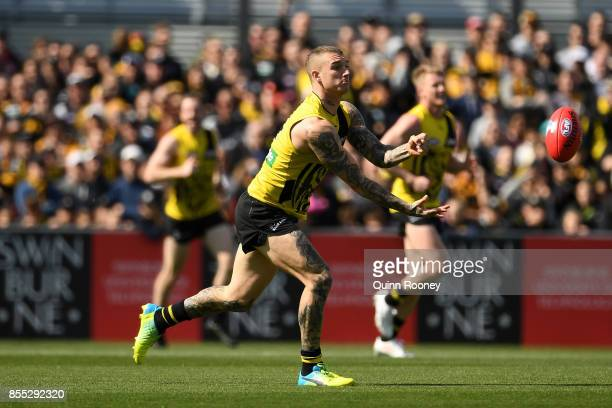 Dustin Martin of the Tigers handpasses during a Richmond Tigers AFL training session at Punt Road Oval on September 29 2017 in Melbourne Australia