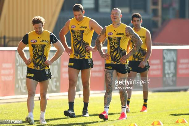 Dustin Martin of the Tigers has a laugh with Kane Lambert, Toby Nankervis and Marlion Pickett of the Tigers during a Richmond Tigers AFL training...