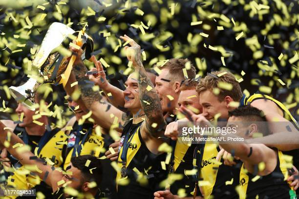 Dustin Martin of the Tigers holds aloft the Premiership Trophy after victory in the 2019 AFL Grand Final match between the Richmond Tigers and the...