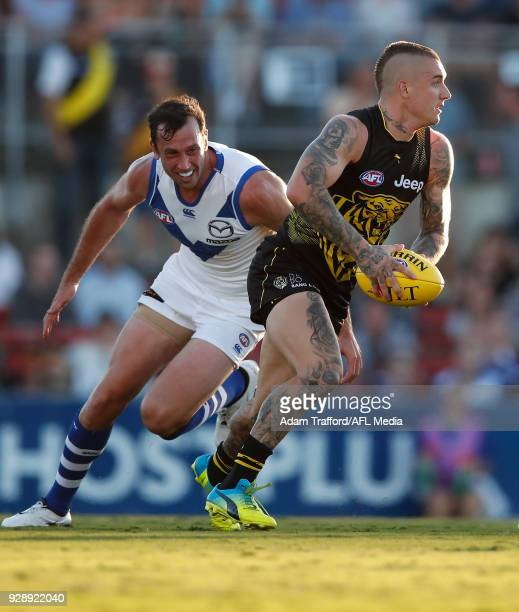 Dustin Martin of the Tigers in action ahead of Todd Goldstein of the Kangaroos during the AFL 2018 JLT Community Series match between the Richmond...