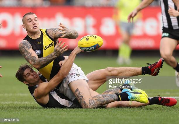 Dustin Martin of the Tigers is challenged by Josh Thomas of the Magpies during the AFL round six match between the Collingwood Magpies and Richmond...
