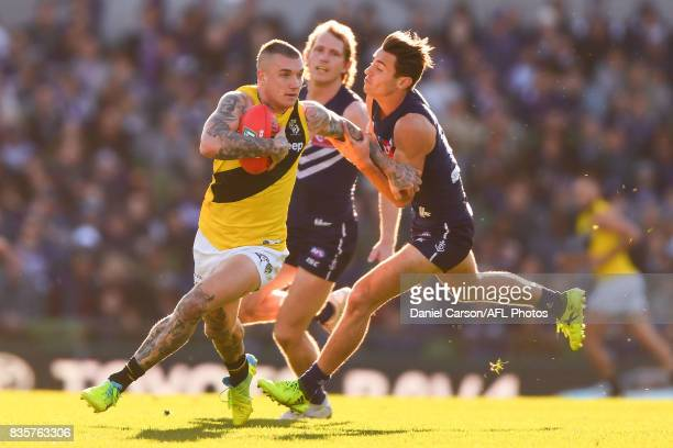 Dustin Martin of the Tigers is held up by Lachie Weller of the Dockers during the 2017 AFL round 22 match between the Fremantle Dockers and the...