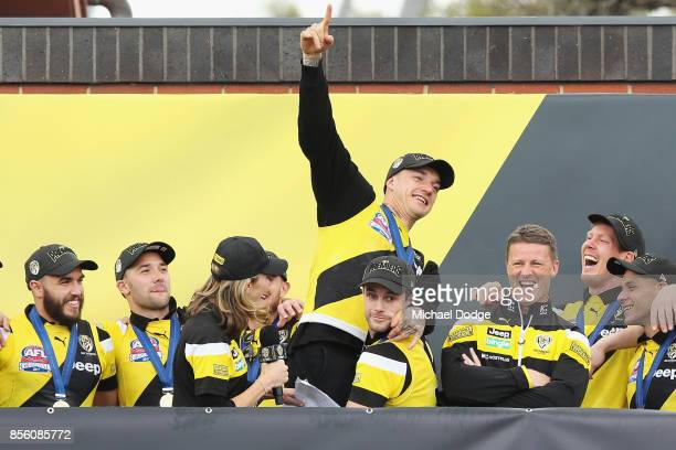Dustin Martin of the Tigers is hoisted by by Trent Cotchin as players celebrate winning yesterday's AFL Grand Final at Punt Road Oval on October 1...