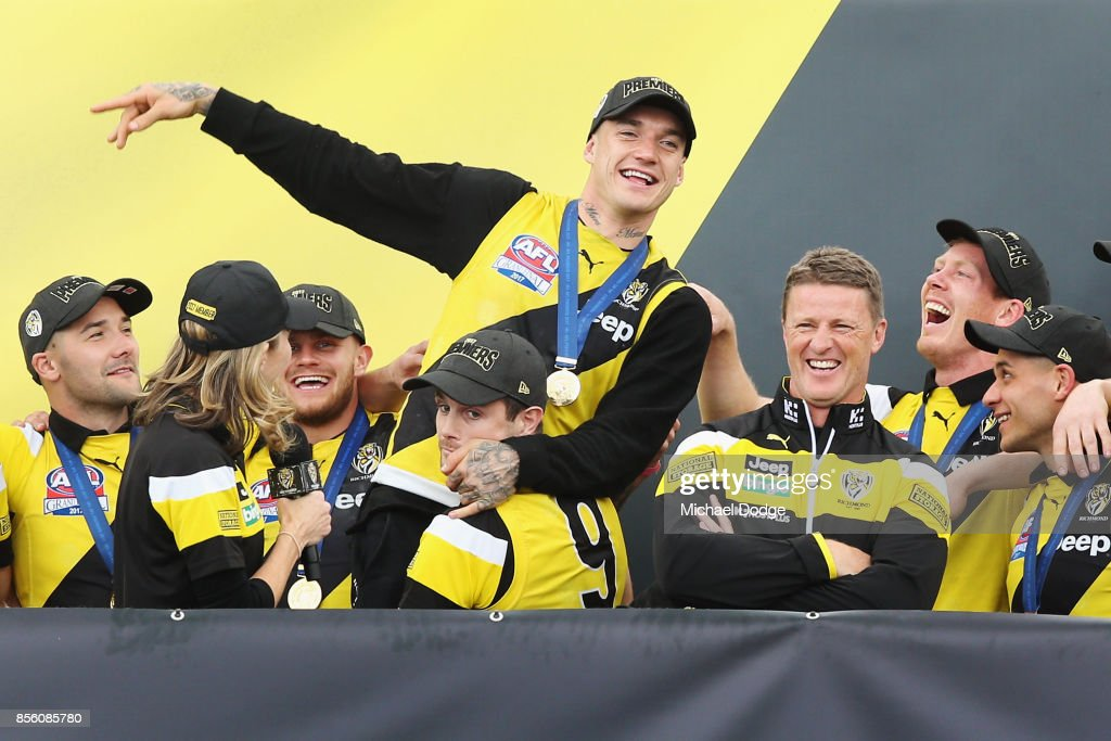 Dustin Martin of the Tigers is hoisted by by Trent Cotchin as players celebrate winning yesterday's AFL Grand Final, at Punt Road Oval on October 1, 2017 in Melbourne, Australia.