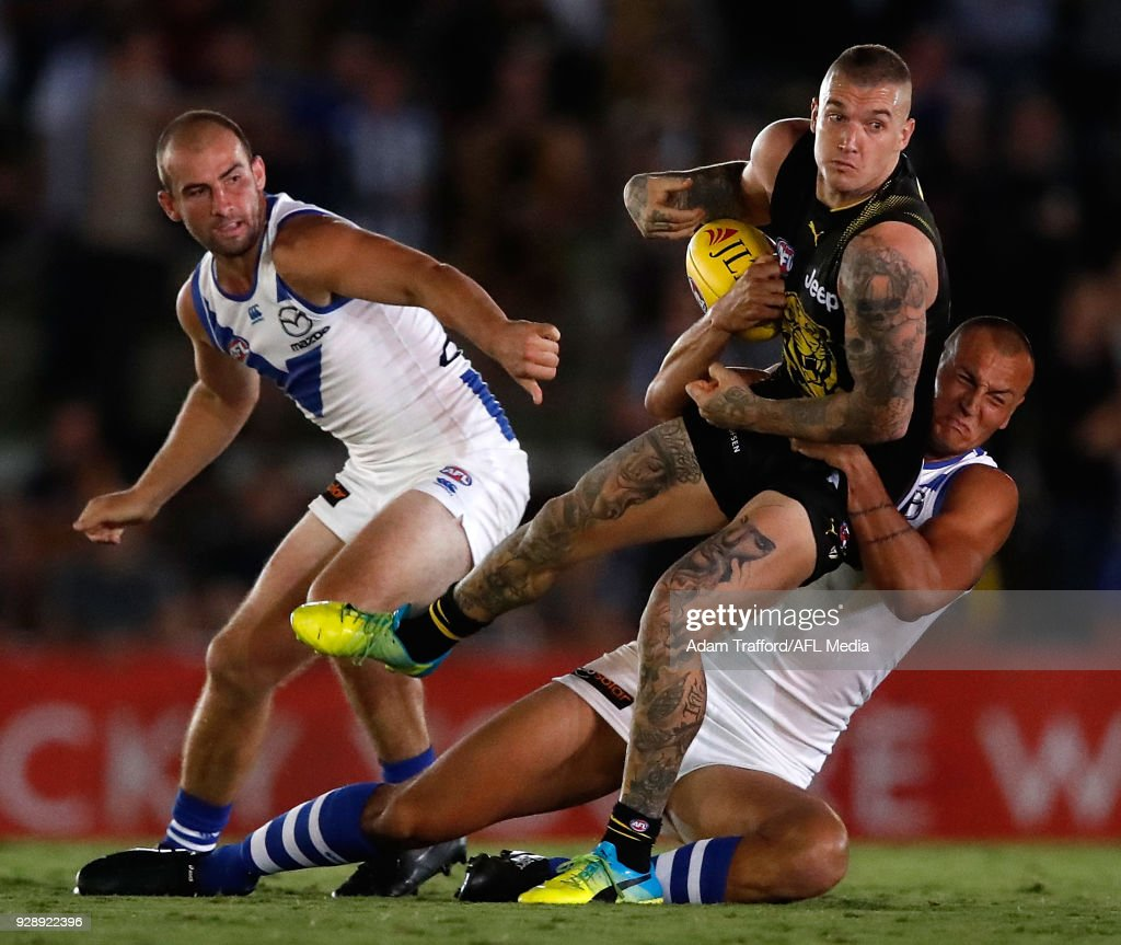 Dustin Martin of the Tigers is tackled by Braydon Preuss of the Kangaroos during the AFL 2018 JLT Community Series match between the Richmond Tigers and the North Melbourne Kangaroos at Ikon Park on March 7, 2018 in Melbourne, Australia.