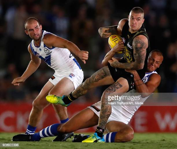 Dustin Martin of the Tigers is tackled by Braydon Preuss of the Kangaroos during the AFL 2018 JLT Community Series match between the Richmond Tigers...