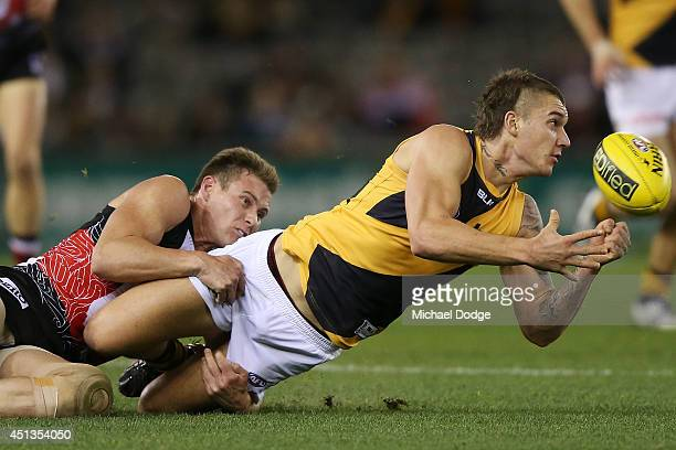 Dustin Martin of the Tigers is tackled by David Armitage of the Saints during the round 15 AFL match between the St Kilda Saints and the Richmond...
