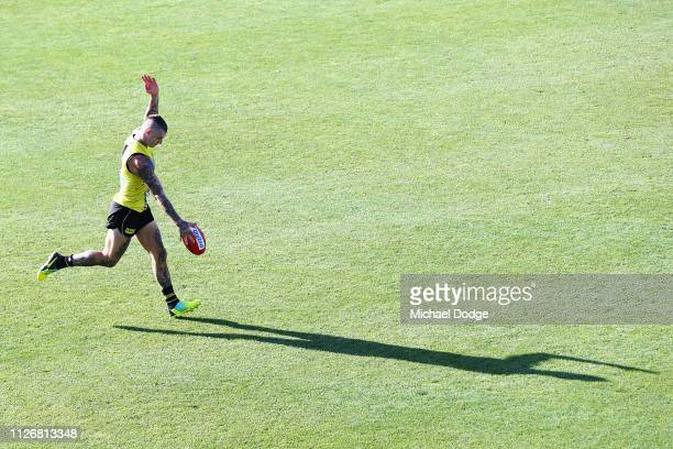 Dustin Martin of the Tigers kicks the ball during a Richmond Tigers AFL training session at Punt Road Oval on February 02, 2019 in Melbourne,...
