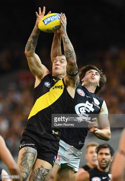 Dustin Martin of the Tigers marks infront of Caleb Marchbank of the Blues during the round one AFL match between the Richmond Tigers and the Carlton...