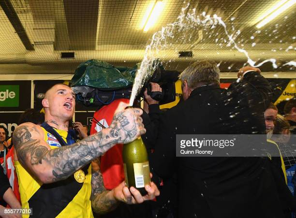 Dustin Martin of the Tigers pops some champagne in the rooms after winning the 2017 AFL Grand Final match between the Adelaide Crows and the Richmond...