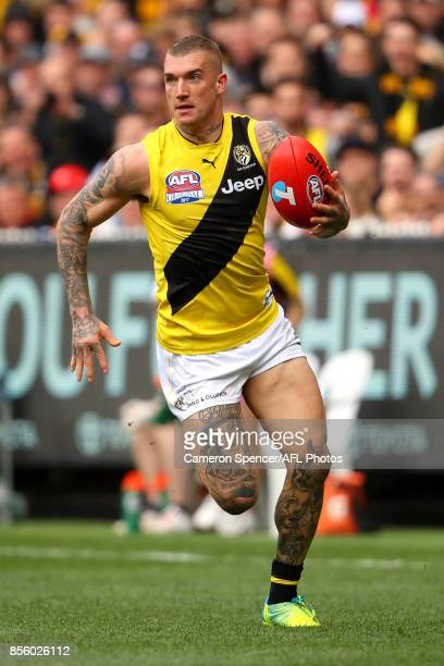 Dustin Martin of the Tigers runs the ball during the 2017 AFL Grand Final match between the Adelaide Crows and the Richmond Tigers at Melbourne...