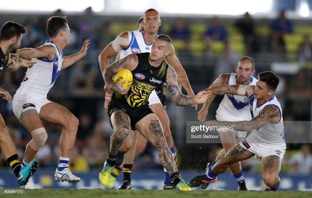 Dustin Martin of the Tigers runs with the ball during the AFL JLT Community Series match between the Richmond Tigers and the North Melbourne Kangaroos at Ikon Park on March 7, 2018 in Melbourne, Australia.