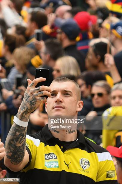 Dustin Martin of the Tigers takes photos of the crowd during the 2017 AFL Grand Final Parade on September 29 2017 in Melbourne Australia