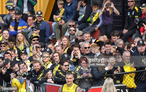 Dustin Martin of the Tigers walks out to train as Tigers supporters in the crowd look on during a Richmond Tigers AFL training session at Punt Road...
