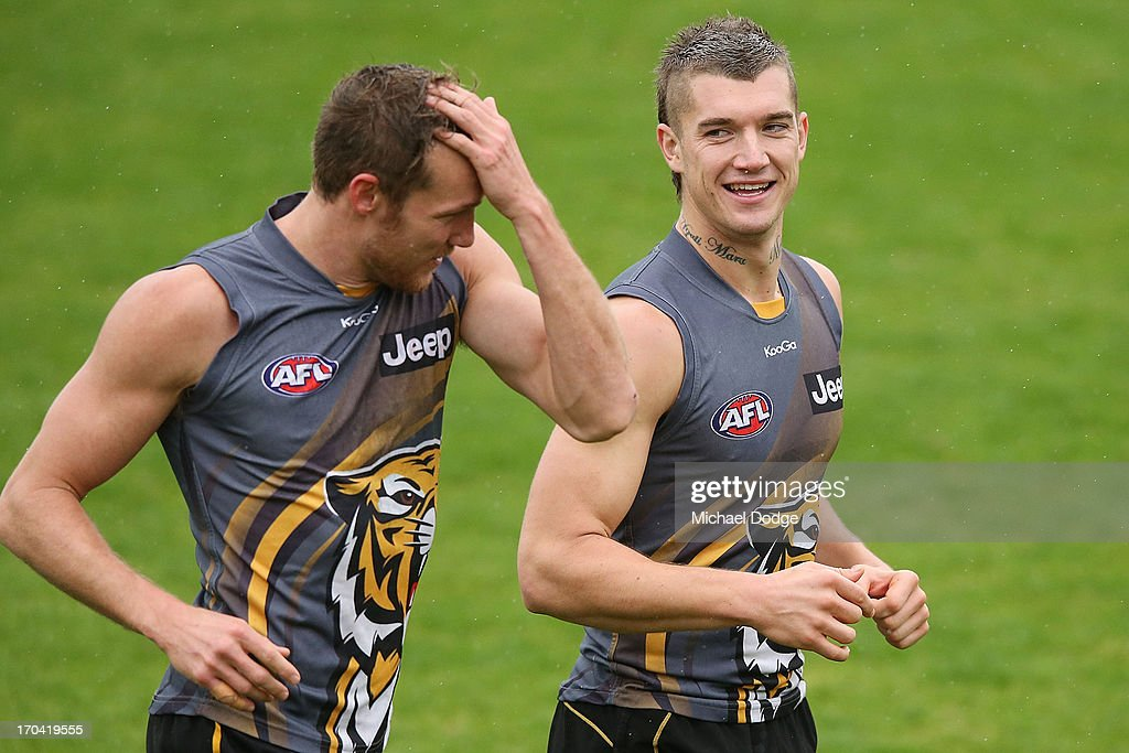 Dustin Martin (R) reacts next to Luke McGuane during a Richmond Tigers AFL training session at ME Bank Centre on June 13, 2013 in Melbourne, Australia.