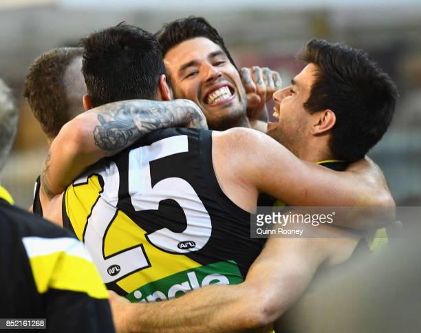 Dustin Martin Toby Nankervis Alex Rance and Trent Cotchin of the Tigers celebrate winning the Second AFL Preliminary Final match between the Richmond...