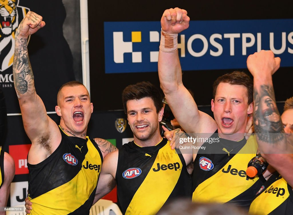 Dustin Martin, Trent Cotchin and Dylan Grimes of the Tigers celebrate in the rooms after winning the AFL Second Qualifying Final Match between the Geelong Cats and the Richmond Tigers at Melbourne Cricket Ground on September 8, 2017 in Melbourne, Australia.