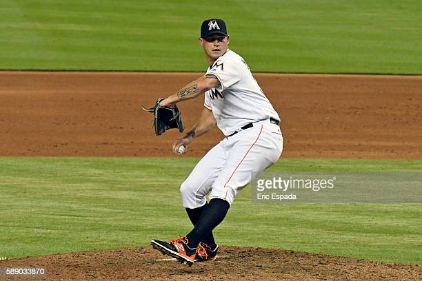 Dustin McGowan of the Miami Marlins throws a pitch during the sixth inning against the Chicago White Sox at Marlins Park on August 12 2016 in Miami...