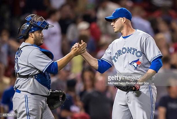 Dustin McGowan of the Toronto Blue Jays congratulates Dioner Navarro after pitching the ninth inning of a 61 win over the Boston Red Sox on July 30...